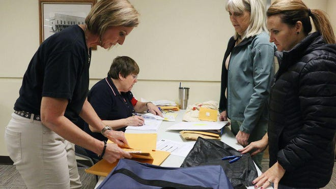 From left, Ellis County Deputy Clerk Bobbi Dreiling and County Clerk Donna Maskus check ballots in 2018 at the Ellis County Administrative Center in Hays.