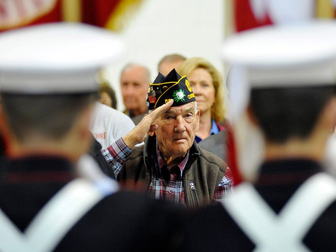 Nason Baker salutes the flag during a Veterans Day