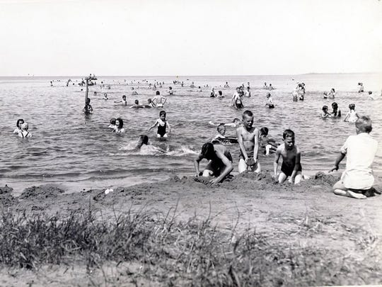 Before pollution closed the beach in the 1940s, people would flock to Bay Beach on hot summer days.