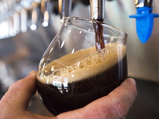 A porter is poured from the tap at Maxline Brewing.