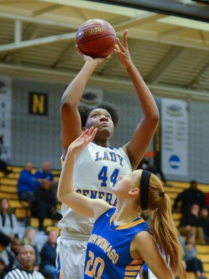 Milwaukee King's Sydnee Roby shoots over Mukwonago' s Sarah Pavletich during a game this past season. Roby was announced as the Associated Press state player of the year Thursday.