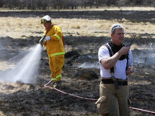 San Juan County District 2 firefighters from Flora Vista extinguish a fire March 29, 2014, at 720 County Road 3000.
