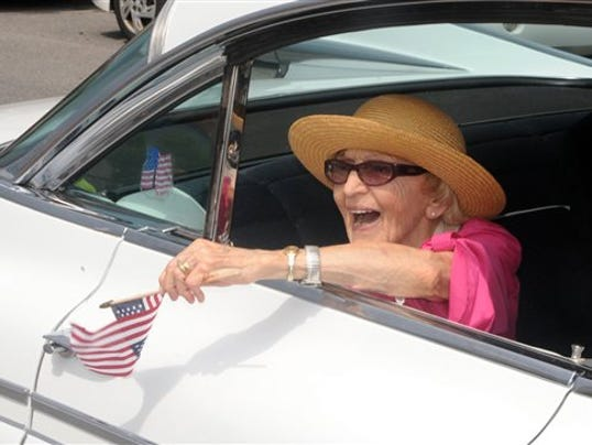 In this June 30, 2012 file photo, parade grand marshall actress Ellen Albertini Dow waves to the crowd as she rides in the back of a classic car during the Six-County Firemen's Parade in Mount Carmel, Northumberland County.
