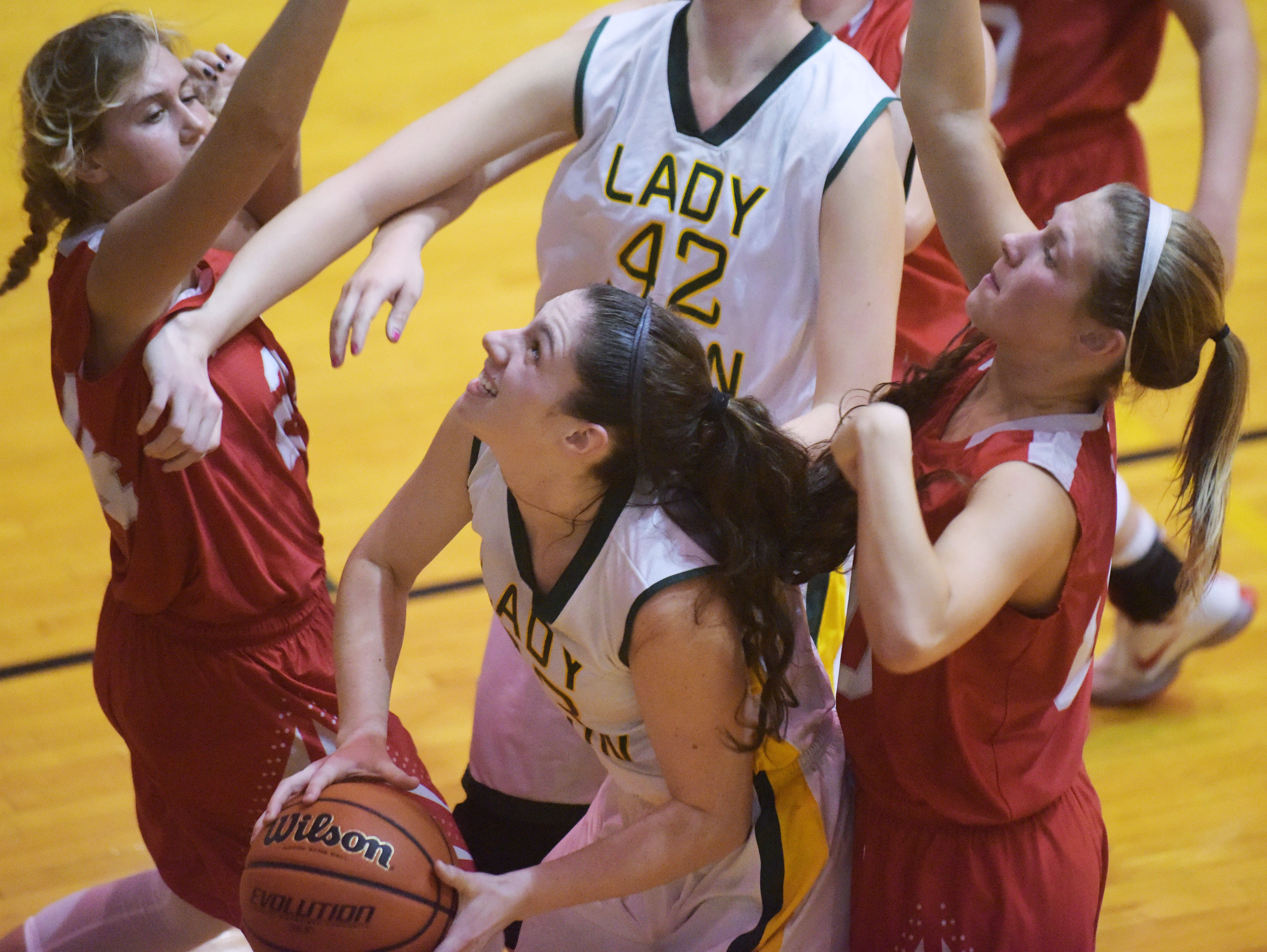 Benton Central's Betsy Marquie tries to score past two defenders Thursday, December 10, 2015 at Benton Central High School. Benton Central was victorious over West Lafayette.