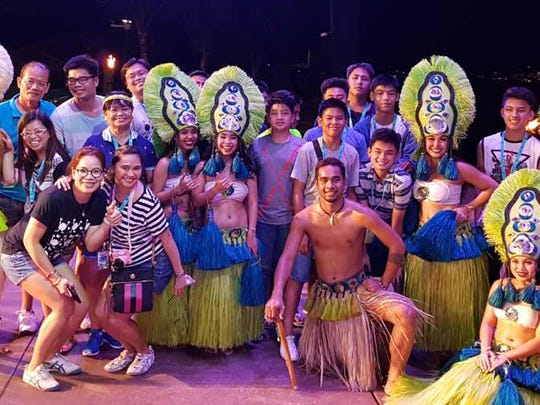 Members of the De La Salle University's All-Star Select team visited Guam for the Pacific Summer Invitational U15 Basketball Tournament and were able to take in some of our cultural events. In this photo they pose with dancers from the Tao Tao Tasi show.