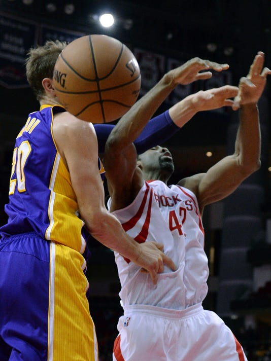 Houston Rockets center Nene (42) loses a rebound against Los Angeles Lakers center Timofey Mozgov (20) in the first half of an NBA basketball game on Wednesday, Dec. 7, 2016, in Houston. (AP Photo/George Bridges)