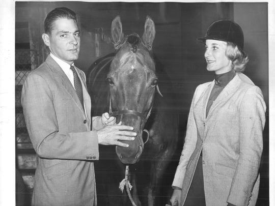 Frank Chapot with Wait-a-While and Donna G. Kaufmann of Rochester, New York, at the National Horse Show at Madison Square Garden in New York in 1962.