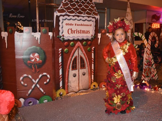 Vizcaya Borunda, 5, poses after winning Most Christmas Spirit during the Little Miss and Mr. Christmas Pageant Saturday.