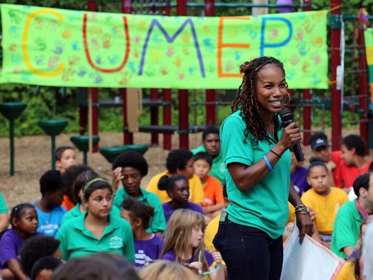 Nia Nunn Makepeace, executive director of the Southside Community Center, speaks to the crowd at a concert to conclude the Community Unity Music Education Program Thursday night.