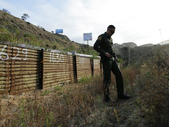 In this June 22, 2016 photo, Border Patrol agents stands