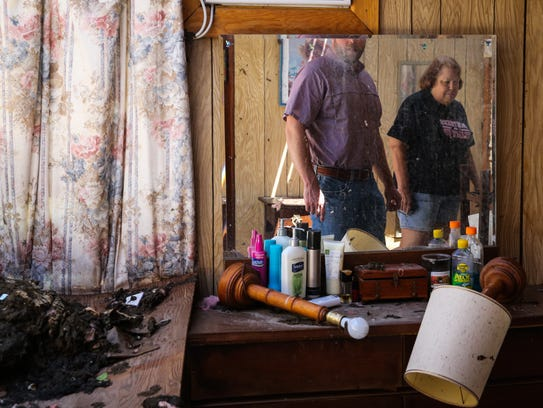 Todd Peters and Janell Fields look around the remains of her mother's house Aug. 30 after Hurricane Harvey swept through Lamar.