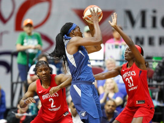 Mystics forward Myisha Hines-Allen (2) and Mystics forward Asia Taylor (31) defend as Lynx center Sylvia Fowles (34) turns to the basket Sunday, May 6, 2018, during their WNBA preseason game at Wells Fargo Arena in Des Moines, Iowa.