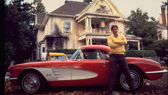 Tim Matheson (Otter) next to one of the cars he didn't