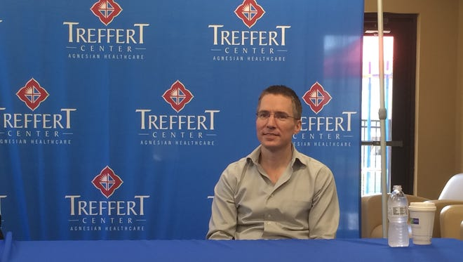 Acquired savant Jason Padgett spoke about his transformation into a mathematical genius Monday at the Treffert Center in Fond du Lac.