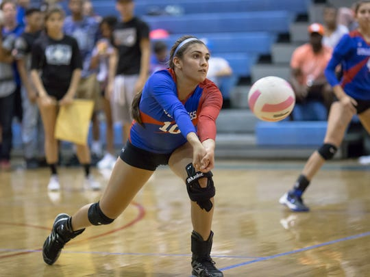 Las Cruces High outside hitter Alyssa Barrera defends