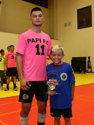 Papi FC's Ashton Surber was presented the 2017 Budweiser Futsal League Golden Boot Award.Douglas Kelly, right, presented the trophy to Surber (No. 11).
