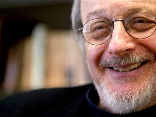 American author E.L. Doctorow smiles during an interview in his office at New York University in New York on April 27, 2004.