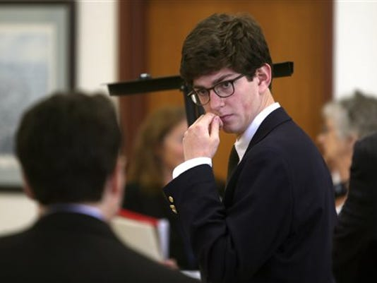 """Former St. Paul's student Owen Labrie confers with his lawyer before the start of the second day of his trial at Merrimack County Superior Court in Concord, N.H., Wednesday, Aug. 19, 2015. Labrie is accused of raping a 15-year-old freshman as part of the """"Senior Salute,"""" a practice of sexual conquest at the prestigious St. Paul's School in Concord."""
