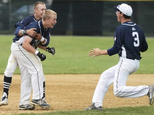 Brett Kinneman, second from left, prepares to get mobbed by his teammates after delivering the game-winning hit.