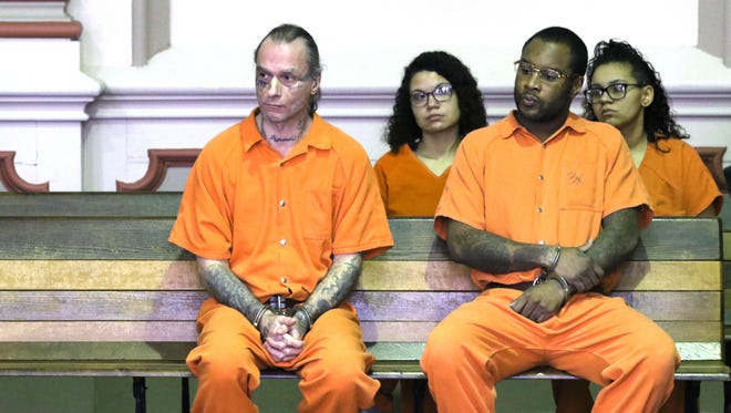 Michael Thundercloud, left, and Brian Ross, listen to the proceedings for co-defendant Danell Vann in Muskingum County Common Pleas Court on Monday. The pair were each sentenced to more than 20 years for their roll in a video-taped assault in Zanesville last year. Vann got 13 years for his role.