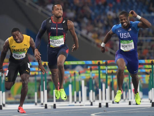 American Jeff Porter (right) and Dimitri Bascou of France compete in the men's 110-meter hurdles semifinal Tuesday during track and field competition in the Rio 2016 Summer Olympic Games.