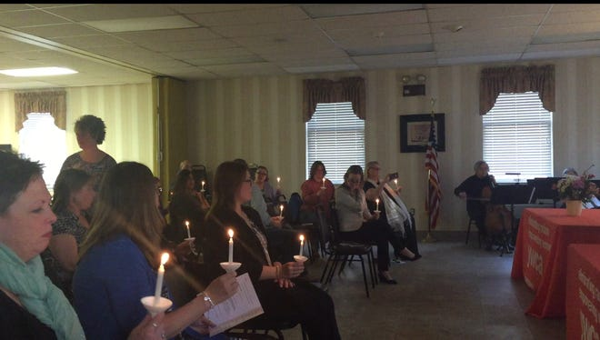 Attendees light candles to honor victims of crimes, survivors and those who help victims during a candlelight vigil at YWCA Hanover Safe Home on April 11.