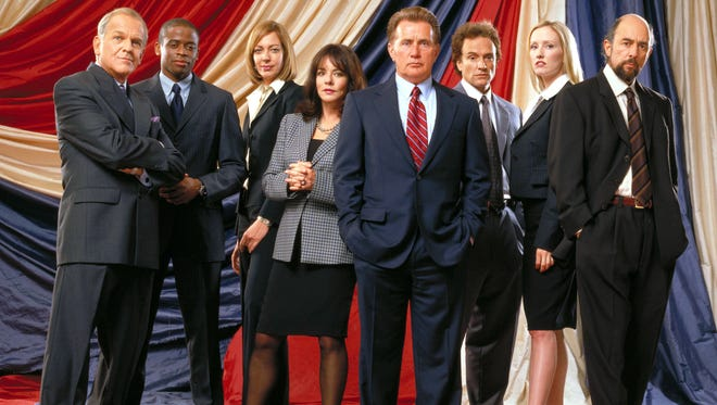 """The cast of """"The West Wing"""" in 2003: John Spencer as Chief of Staff Leo McGarry, Dule Hill as aide Charlie Young, Allison Janney as Press Secretary CJ Gregg, Stockard Channing as First Lady Abigail Bartlet, Martin Sheen as President Josiah Bartlet, Brad Whitford as Deputy Chief of Staff Josh Lyman, Janel Moloney as Assistant Donna Moss and Richard Schiff as Communications Director Toby Ziegler."""