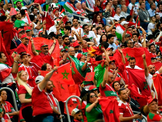 Morocco fans cheer during the game against Iran.