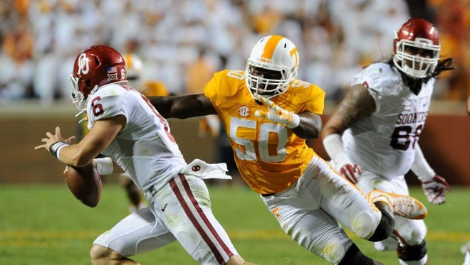 Tennessee defensive lineman Corey Vereen (50) chases Oklahoma quarterback Baker Mayfield (6) during second half action in Neyland Stadium Saturday, Sep. 12, 2015.