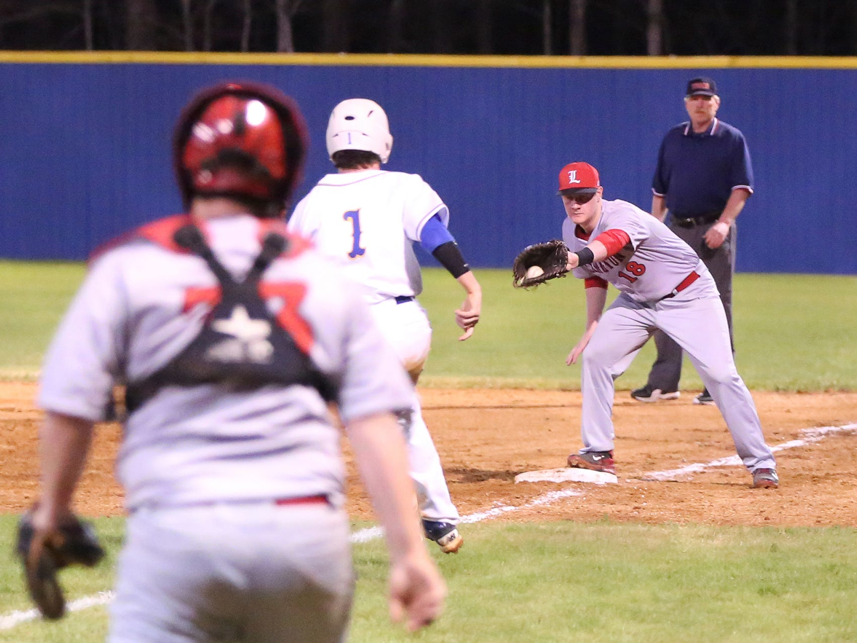 Lexington's Heath Essary makes a catch at first base against McNairy Central earlier this season.