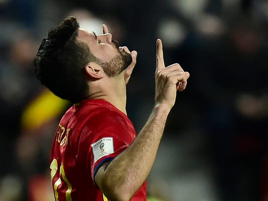 FILE - In this Friday, March 24, 2017 file photo, Spain's Diego Costa celebrates after scoring during a 2018 World Cup Group G qualifying soccer match between Spain and Israel, at El Molinon Stadium, in Gijon, northern Spain. Spain coach Julen Lopetegui has left Chelsea striker Alvaro Morata out of the squad that will play friendlies against Germany and Argentina later in March, 2018, while Diego Costa was included after returning to action with Atletico Madrid. (AP Photo/Alvaro Barrientos, File)