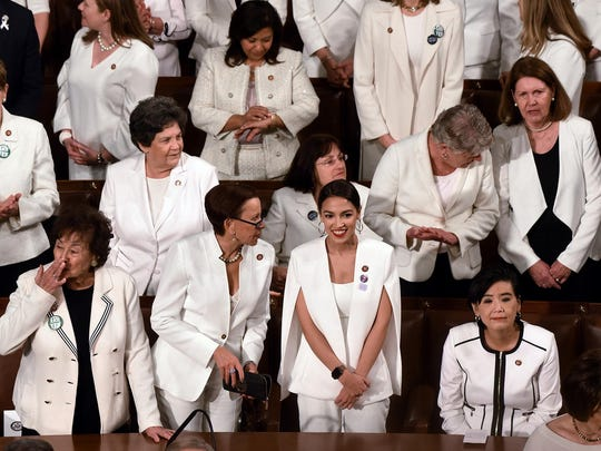 House Democratic women, including Rep. Alexandria Ocasio-Cortez (D-N.Y.), middle, are dressed in white for President Trump's State of the Union address to a joint session of Congress on Capitol Hill in Washington, D.C., on Tuesday, Feb. 5, 2019. (Olivier Douliery/Abaca Press/TNS)