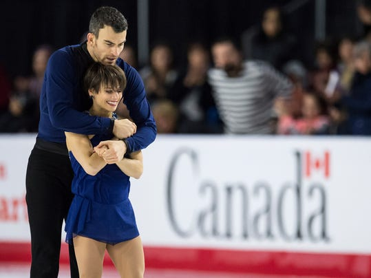 FILE - In this Saturday, Jan. 13, 2018, file photo, Eric Radford, left, and Meagan Duhamel pause on the ice after performing their free program during the senior pairs competition at the Canadian Figure Skating Championships in Vancouver, British Columbia. The figure skating contingent from Team Canada, at 17 strong the largest of any nation, intends to lead its country into the Winter Olympics next week in ways both literal and figurative. (Jonathan Hayward/The Canadian Press via AP)