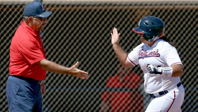 Arizona's Kaityana Mauga is congratulated by head coach Mike Candrea after a home run against South Carolina in the regional in Tucson.