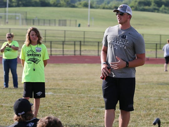 Plymouth alum and Detroit Lions rookie kicker Kyle Brindza (right) talks to participants during Friday's Sunshine's Skills & Drills Football Clinic. At left is Connor Sherman, 11, who spearheaded the program as a way to help kids with special needs experience the game.