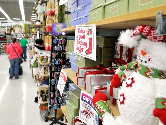 A customer walks down an aisle at Crafts Direct in