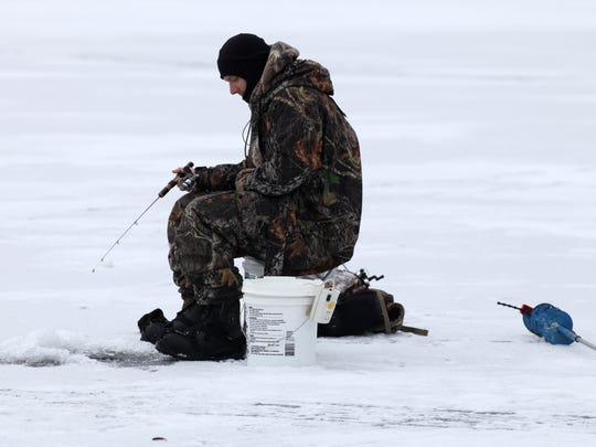 Joe Dutkiewicz from Irondequoit waited for a bite while ice fishing on Irondequoit Bay.