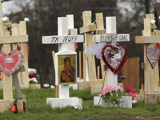 In this Thursday, Feb. 7, 2019, photo, the names of those who died in the Camp Fire are displayed on crosses that make up a memorial in Paradise, Calif.