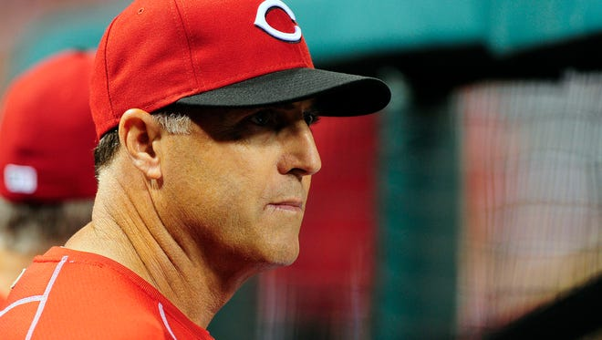 Cincinnati Reds manager Bryan Price (38) looks on during the fifth inning against the St. Louis Cardinals at Busch Stadium. The Cardinals defeated the Reds 2-1.