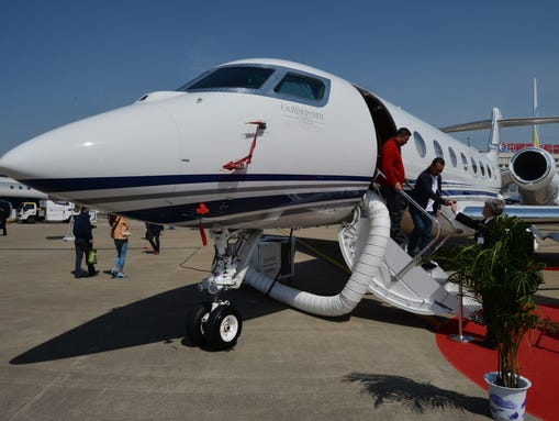 Chinese businessmen leave a Gulfstream G650 luxury