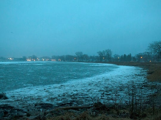 Ice piles up again along the shores of Port Clinton on Wednesday evening.