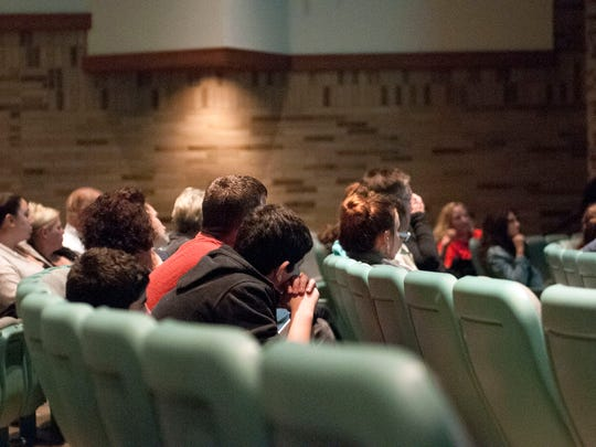 Audience members take in information about human trafficking