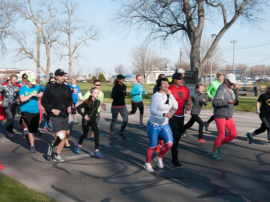 """Sixty runners and walkers completed the Port Clinton Business and Professional Women's """"Superhero 5K"""" through Port Clinton on Sunday morning."""