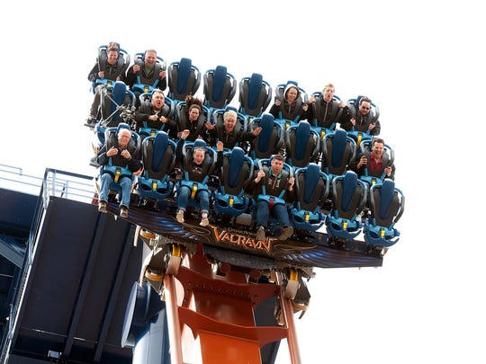 Valravn riders react as they are suspended more than 200 feet in the air for four seconds before diving at a 90 degree angle on Cedar Point's newest coaster on Wednesday May 4, 2016.