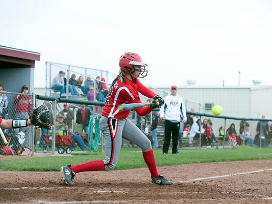 Oak Harbor's Kaytlynn Sandwisch swings the bat during the Rockets' game against Wauseon at Genoa Area High School on Tuesday.