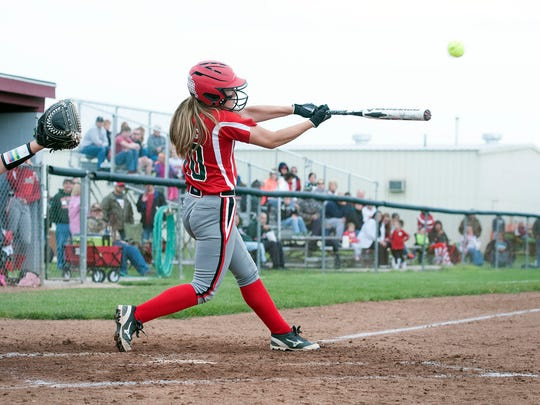 Oak Harbor's Dani Epling hits a double during the Rockets' game against Wauseon at Genoa Area High School on Tuesday.