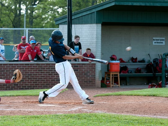 Woodmore's Donovan Reyes hits a single during the Wildcats'