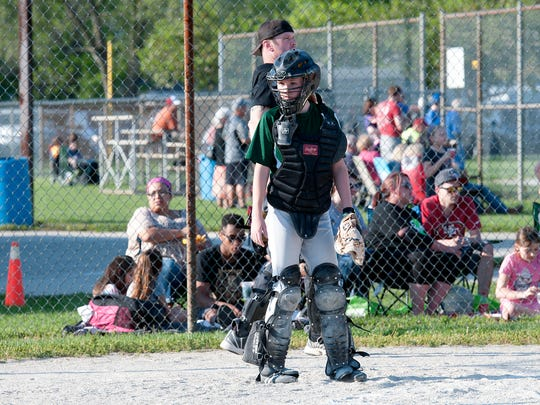 Fremont's Faith Beaver loves to catch, just like former coach Alex Colvin. Beaver, however, is the only girl in her Little League.