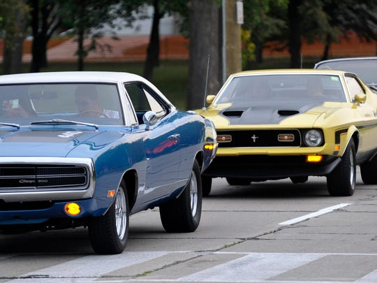 Cruisers line up on Coolidge as they pull into Memorial Park for the car show, including, left to right, a 1970 Dodge Charger 500, a 1972 Ford Mustang Mach 1, a 1962 Dodge 880, which is one of 1700 manufactured and an older model Ford Mustang.  (Todd McInturf, The Detroit News)2017.