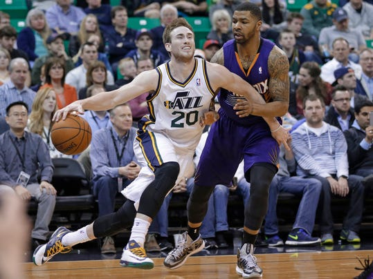 FILE - In this Feb. 26, 2014 file photo, Utah Jazz's Gordon Hayward (20) drives around Phoenix Suns' Marcus Morris during the second half of an NBA basketball game in Salt Lake City. A person close to the situation says restricted free agent Hayward has agreed to a maximum offer sheet with the Charlotte Hornets that would pay the small forward $63 million over the next four years. The Jazz would have three days to match the deal once Hayward officially signs the offer sheet. The person commented to The Associated Press on condition of anonymity Wednesday, July 9, 2014, because Hayward can't officially sign the offer sheet until Thursday. (AP Photo/Rick Bowmer, File)